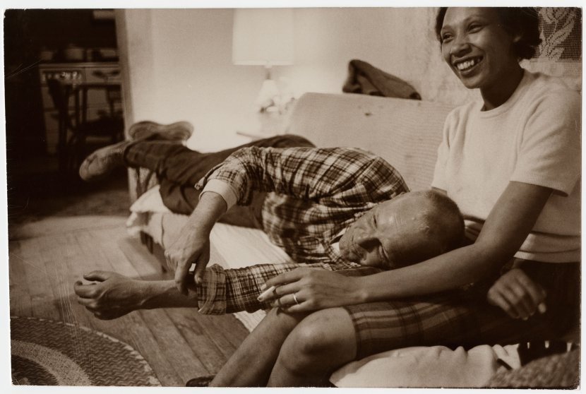 Richard and Mildred Loving laugh while watching television in their living room, King and Queen County, Virginia, April 1965.