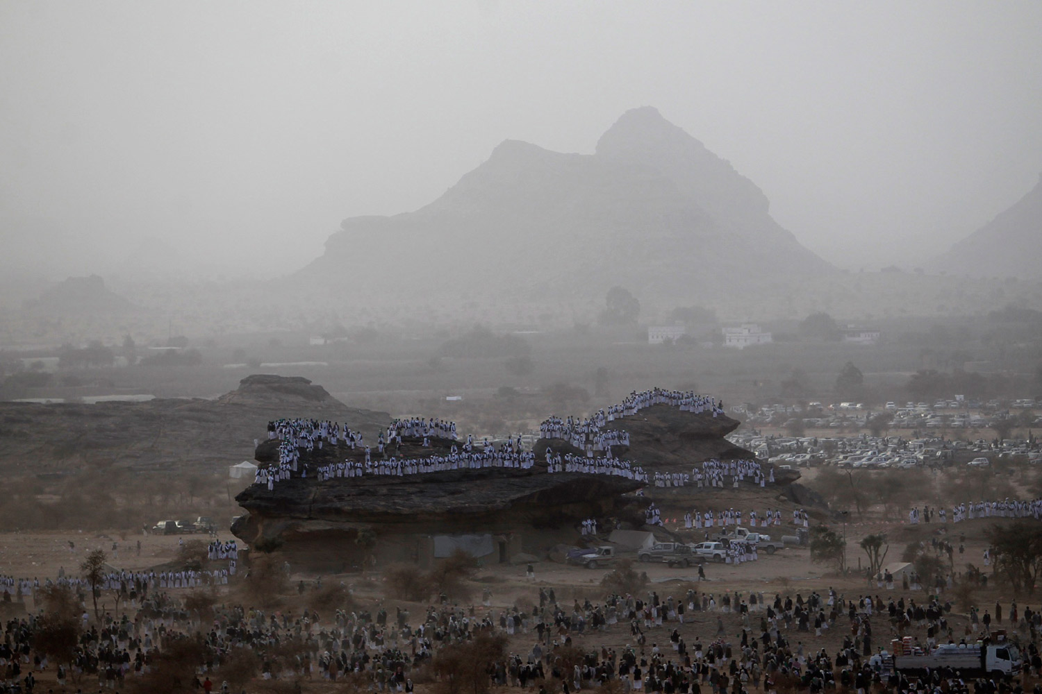 February 4, 2012. Followers of Yemen's Shi'ite sect stand on a hill as others leave a ceremony to mark the birth anniversary of the Prophet Mohammad in Dhahian of the northwestern Yemeni province of Saada.