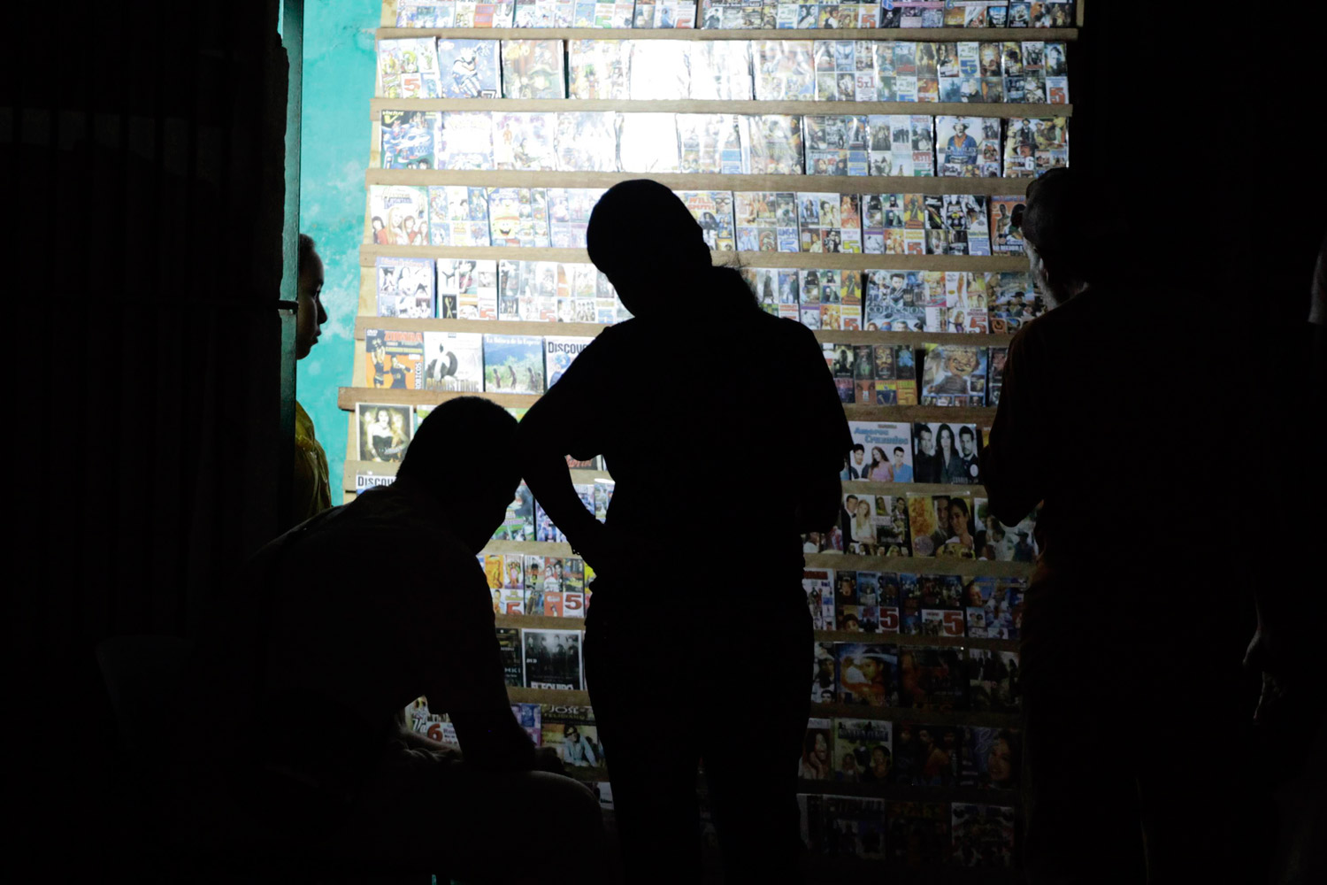 February 4, 2012. People look at DVDs at a privately licensed stall in Havana.