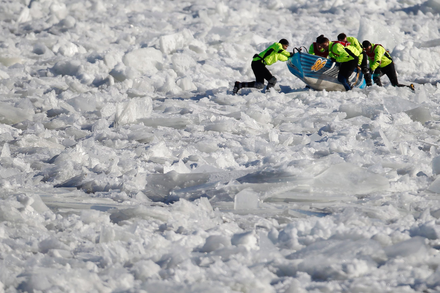 February 5, 2012. Team Innovex competes during the ice canoe race at the Quebec Winter Carnival in Quebec City.