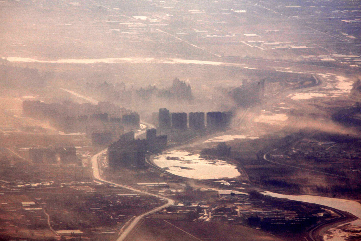 February 6, 2012. Strong winds blow dust over buildings located on the outskirts of Beijing.
