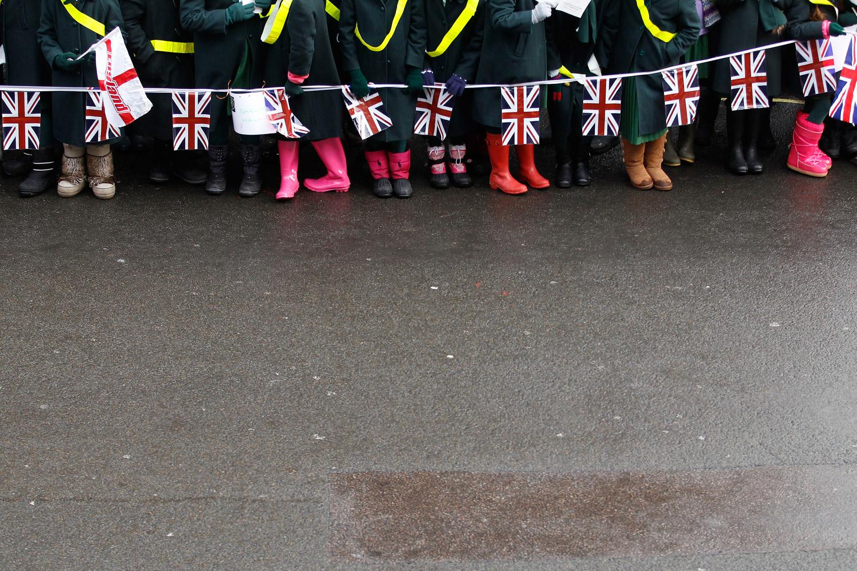 February 6, 2012. Schoolchildren watch the King's Troop Royal Horse Artillery leave St. John's Barracks in London.