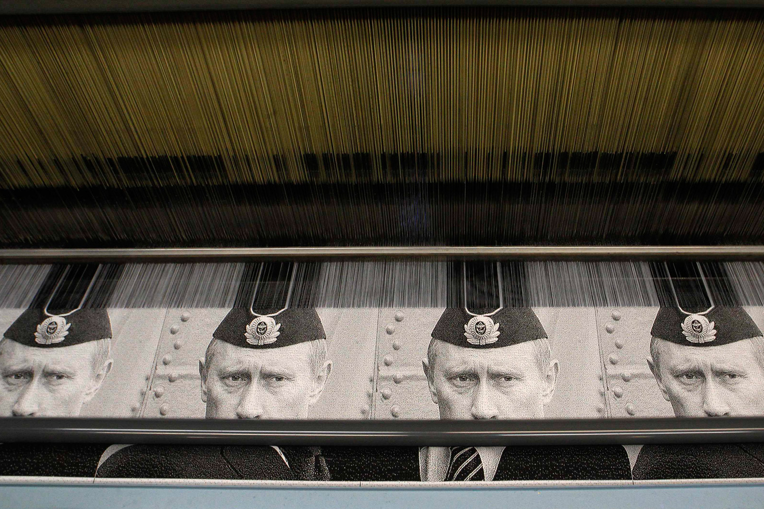 February 6, 2012. A machine works on the production of tapestry fabric, displaying the images of Russia's Prime Minister Vladimir Putin, at the Uzor weaving plant in the town of Vyritsa, north of St. Petersburg.