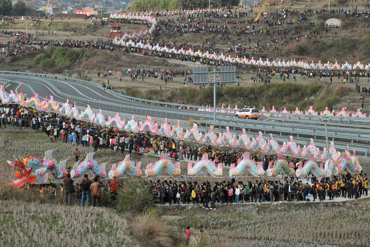 February 6, 2012. Villagers perform the annual  dragon march  to celebrate the Lantern Festival in Gutian township, Fujian province, China.