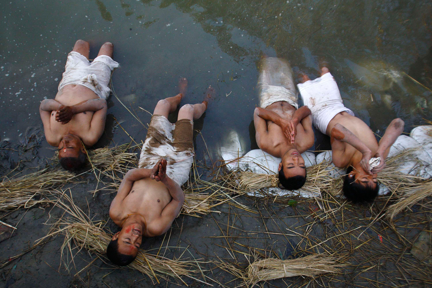 February 7, 2012. Devotees offer prayers by taking a dip on the final day of the month-long Swasthani festival in the Hanumante River at Bhaktapur, near Kathmandu.