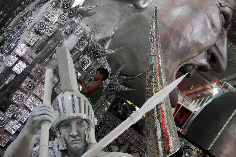 February 7, 2012. A worker prepares a carnival float at Uniao da Ilha Samba School in Rio de Janeiro. The Rio de Janeiro Carnival parade will be held from Feb. 19-20.