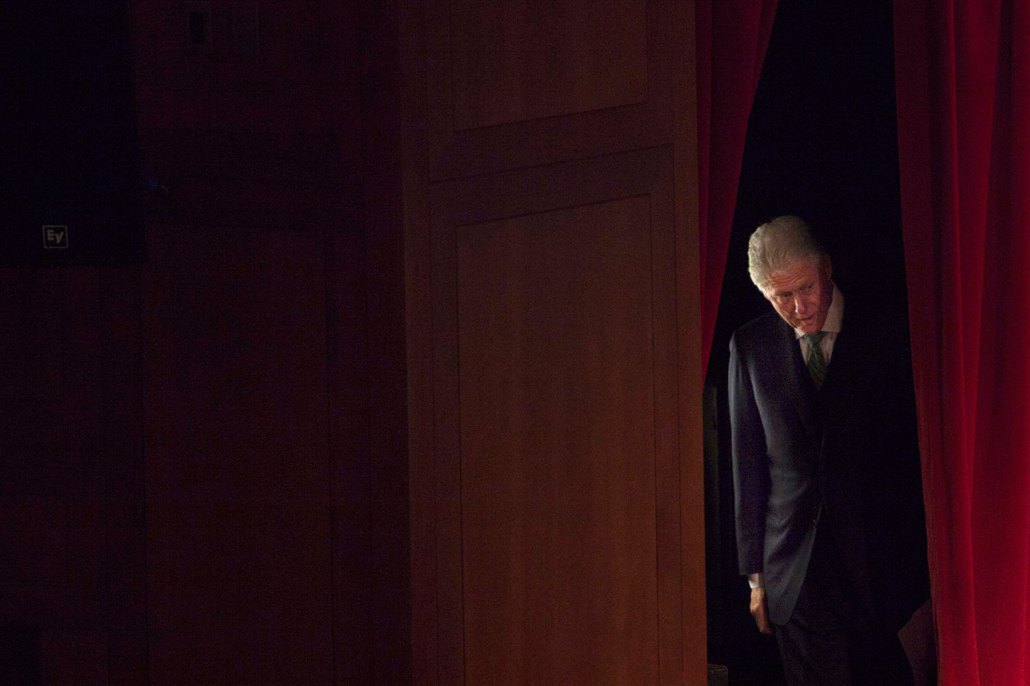 February 9, 2012. Former U.S. President Bill Clinton waits backstage before addressing the crowd at the Invest In Ireland forum at New York University in New York City.