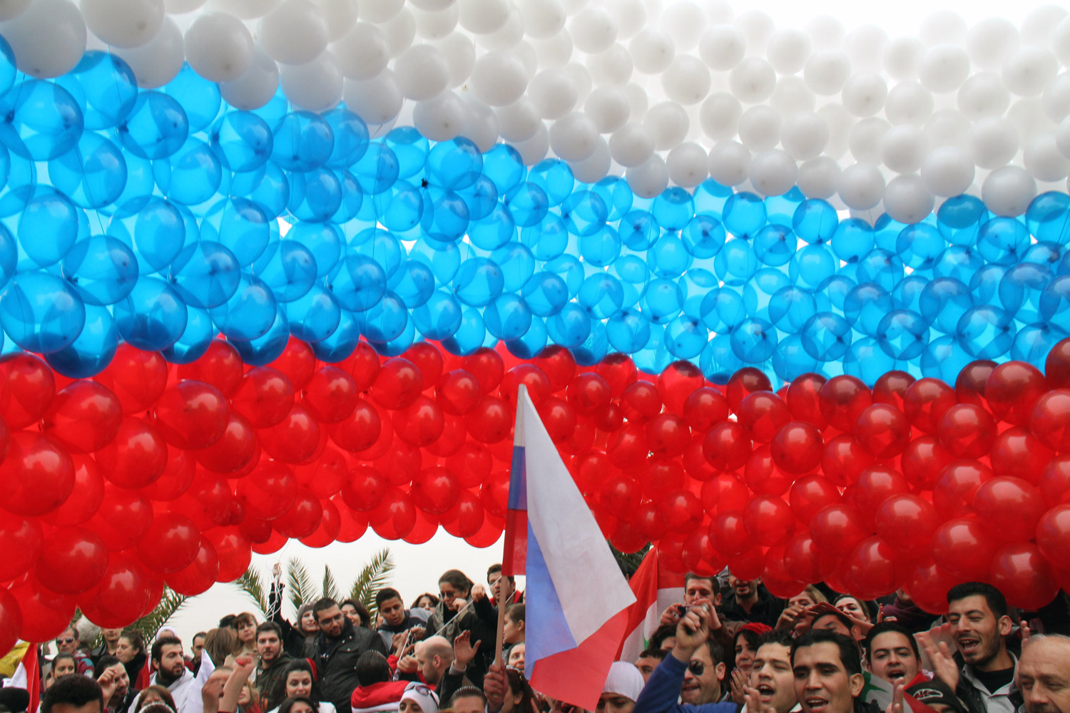 February 7, 2012. Syrians hold balloons combined as a Russian flag to welcome Russian Foreign Minister Sergei Lavrov on the Southern Highway in Damascus.