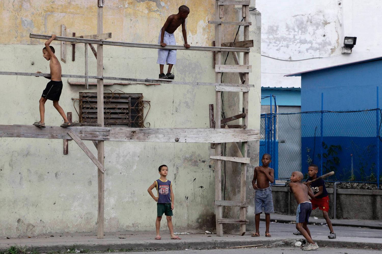 Feb. 26, 2012. Boys play baseball on a street in Havana.