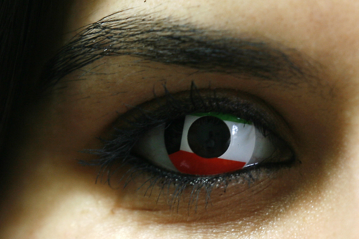 Feb. 24, 2012. A Kuwaiti woman wears a contact lens in the colors of her national flag in Kuwait City on the eve of the Gulf state's 51st Independence Day, and ahead of the 21st anniversary of the end of the Gulf War with the liberation of Kuwait from Iraqi occupation.