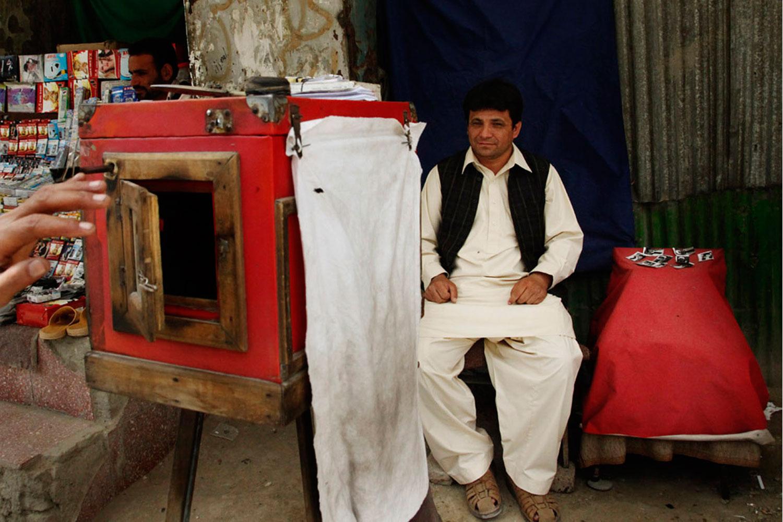 Qalam Nabi takes a photograph.