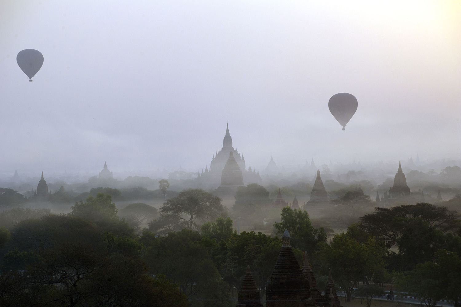 Feb. 26, 2012. Hot air balloons carrying tourists rise above the pagodas at dawn in Myanmar's ancient town of Bagan.
