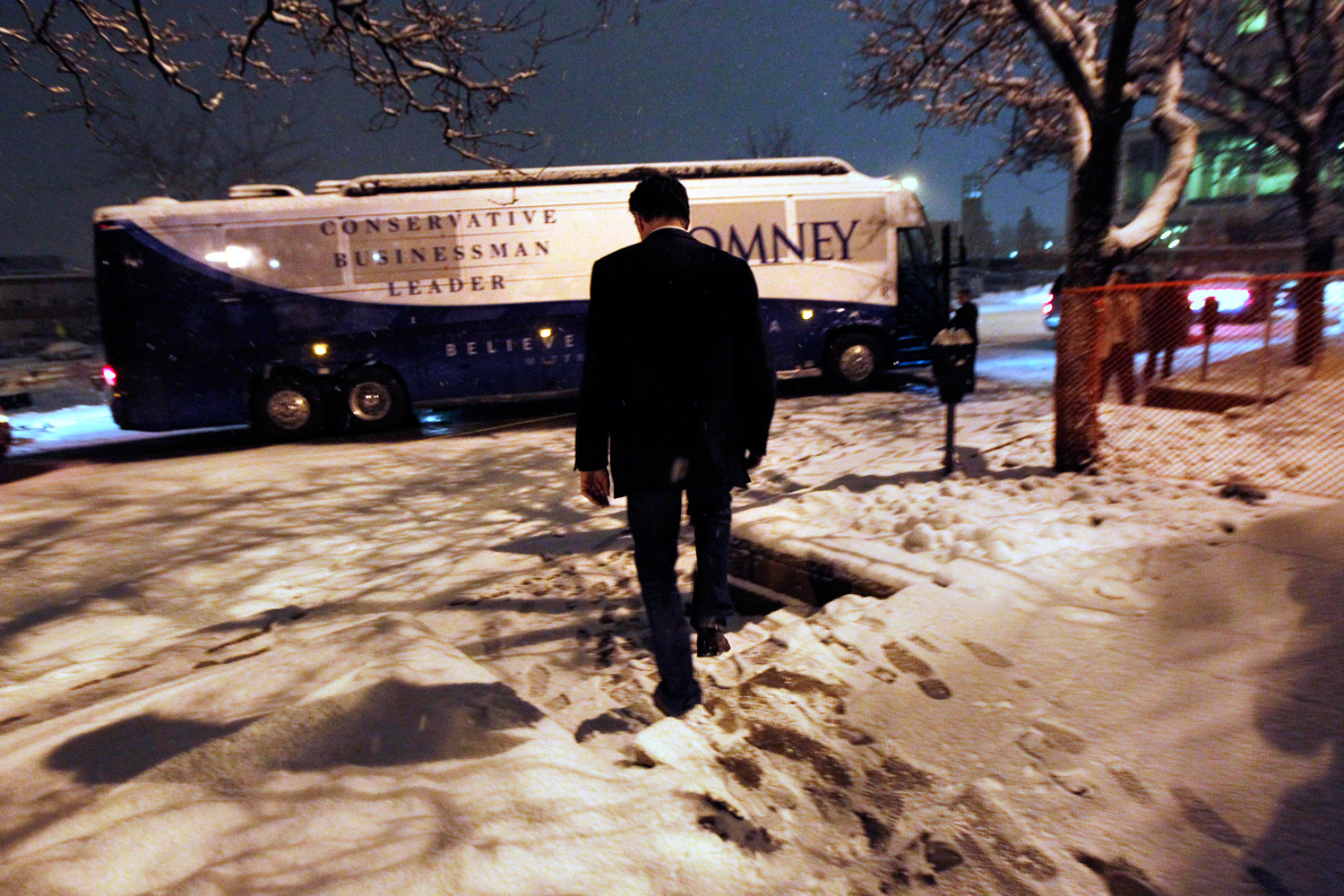Feb. 24, 2012. Republican presidential candidate Mitt Romney walks to his campaign bus after speaking at a town hall meeting in Kalamazoo, Mich.