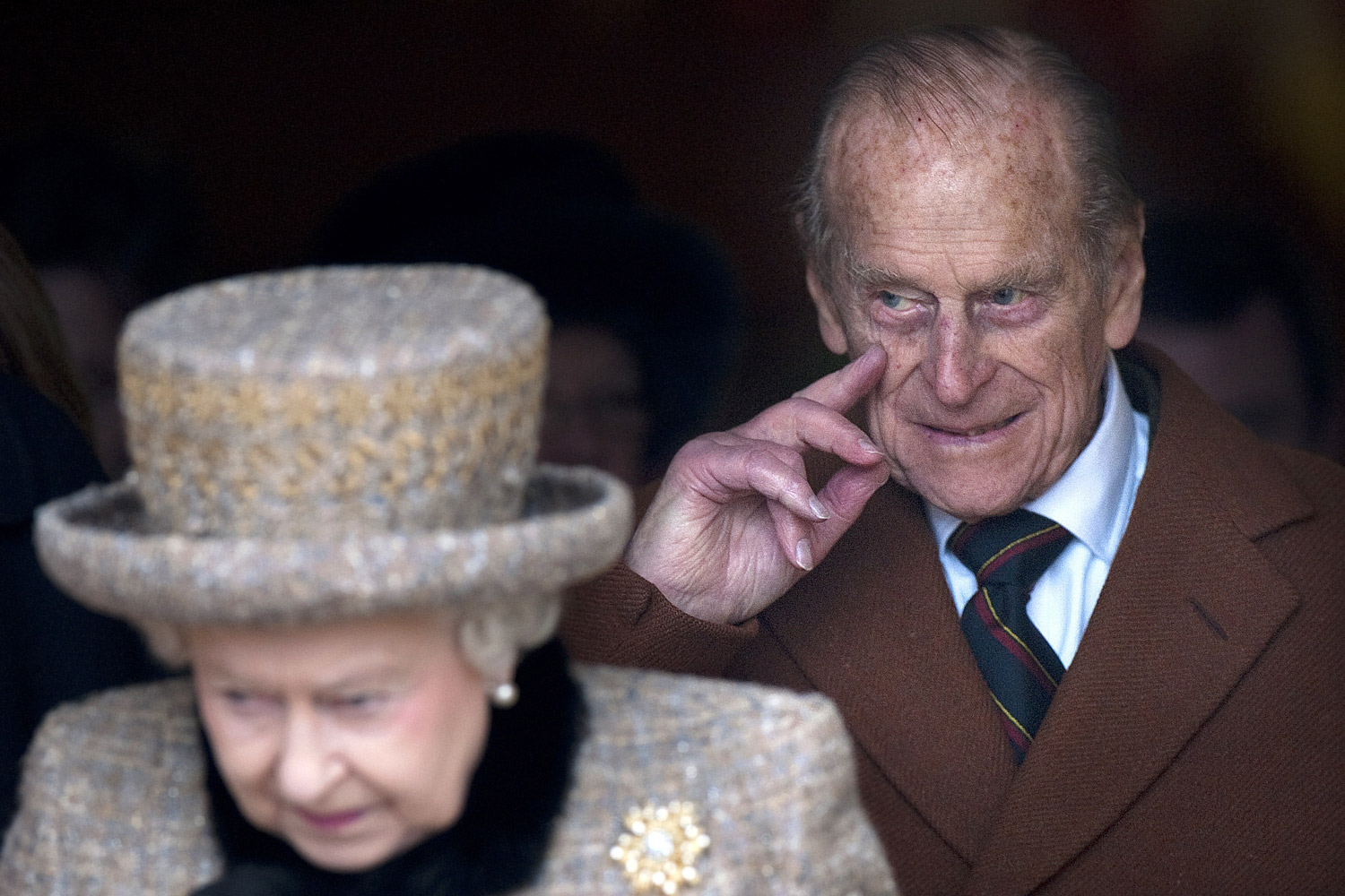 February 5, 2012. Britain's Queen Elizabeth II (L) and The Duke of Edinburgh leave a church service at St. Peters and St. Paul in West Newton, Norfolk. Queen Elizabeth II and her husband Prince Philip braved the snow for a village church service on the eve of the Diamond Jubilee marking 60 years of Elizabeth's reign.