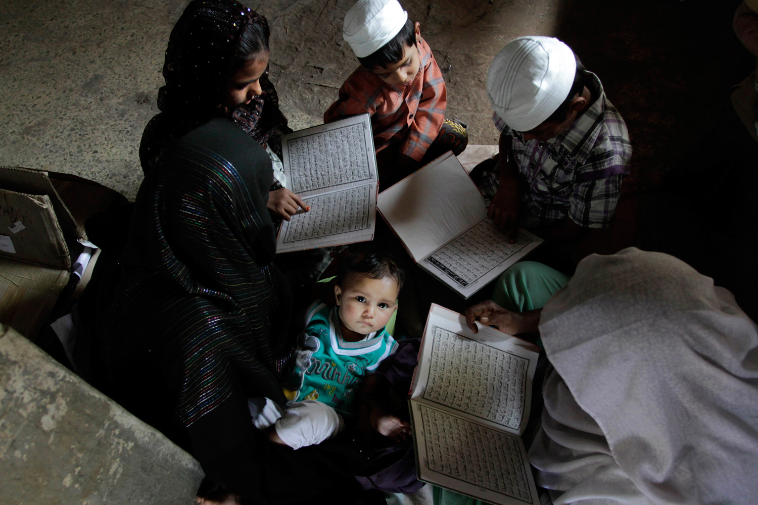 Feb. 27, 2012. An Indian child looks on as others read the Koran at Gulbarg society during a ceremony in Ahmedabad, India.