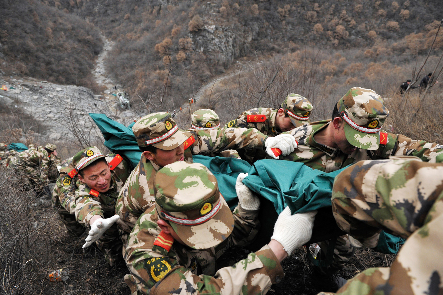 Feb. 25, 2012. Chinese rescuers haul the body of a passenger out of the 50-m (165-ft.) gorge on a stretchers after a bus plunged into a ravine killing 15 tourists and injuring 19 others, near Jincheng in Shanxi province.