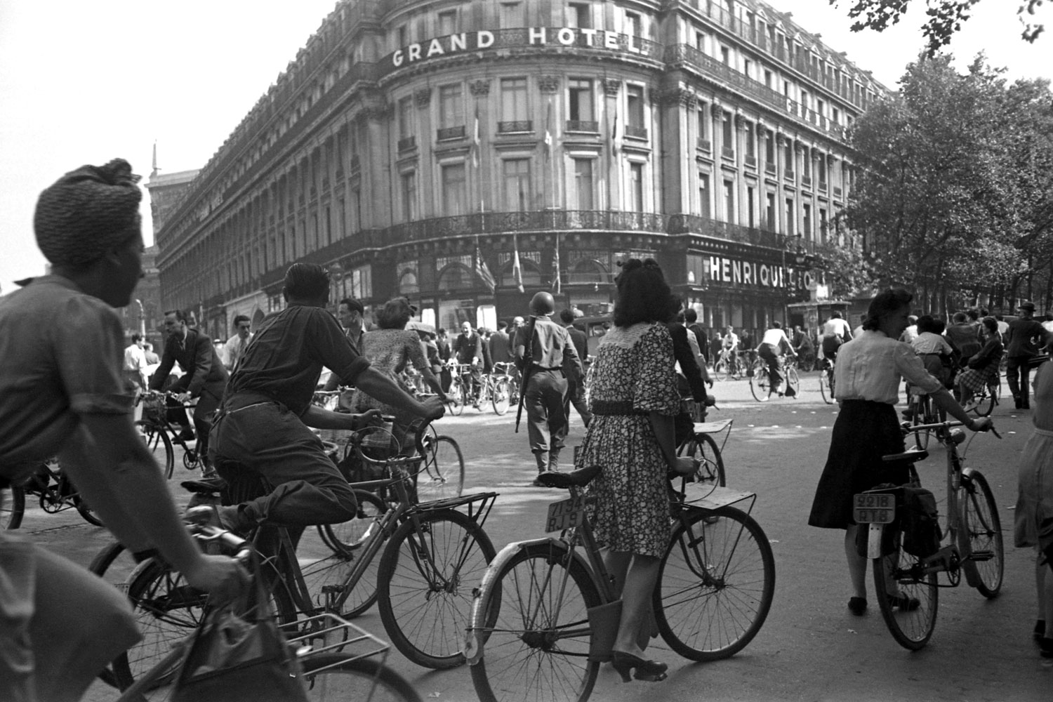 Parisians fill the streets on August 25th, 1944, after occupying German forces surrender.