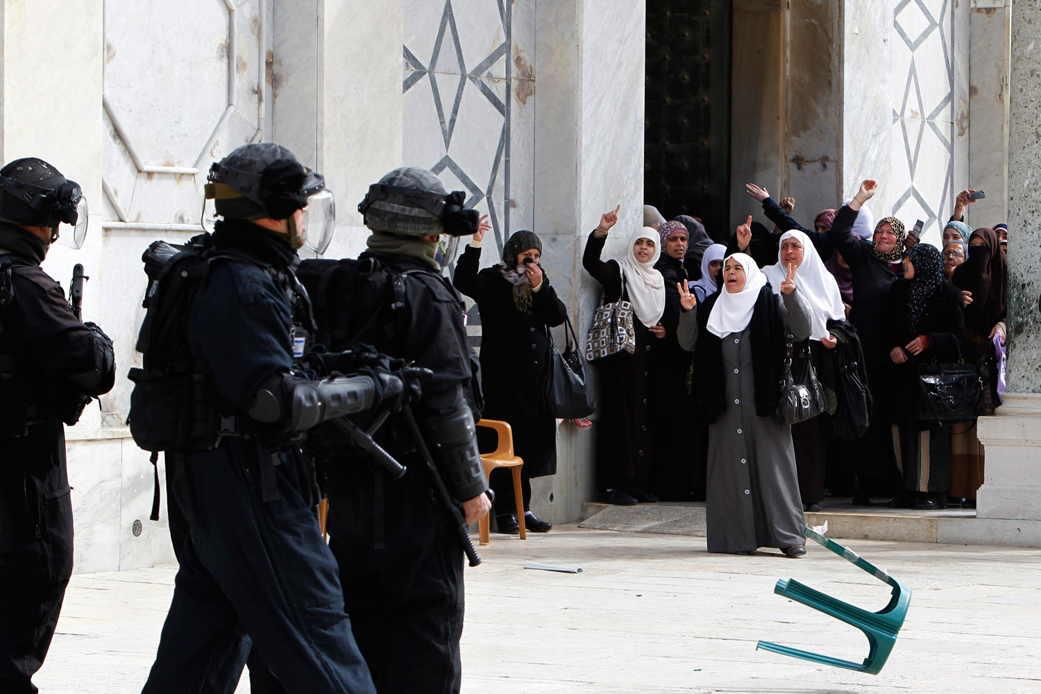 Feb. 24, 2012. Palestinian women gesture as they shout at Israeli policemen during clashes in Jerusalem's Old City.