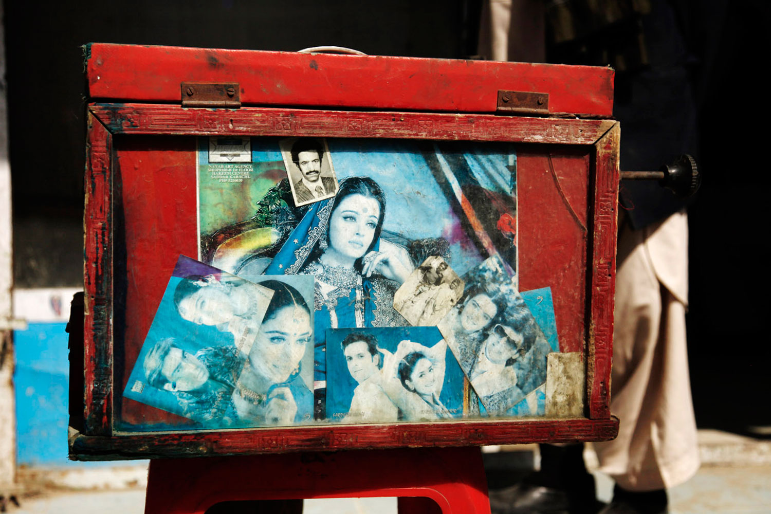 Images decorate Baba Sher's camera. Most are of Hindi movie stars.