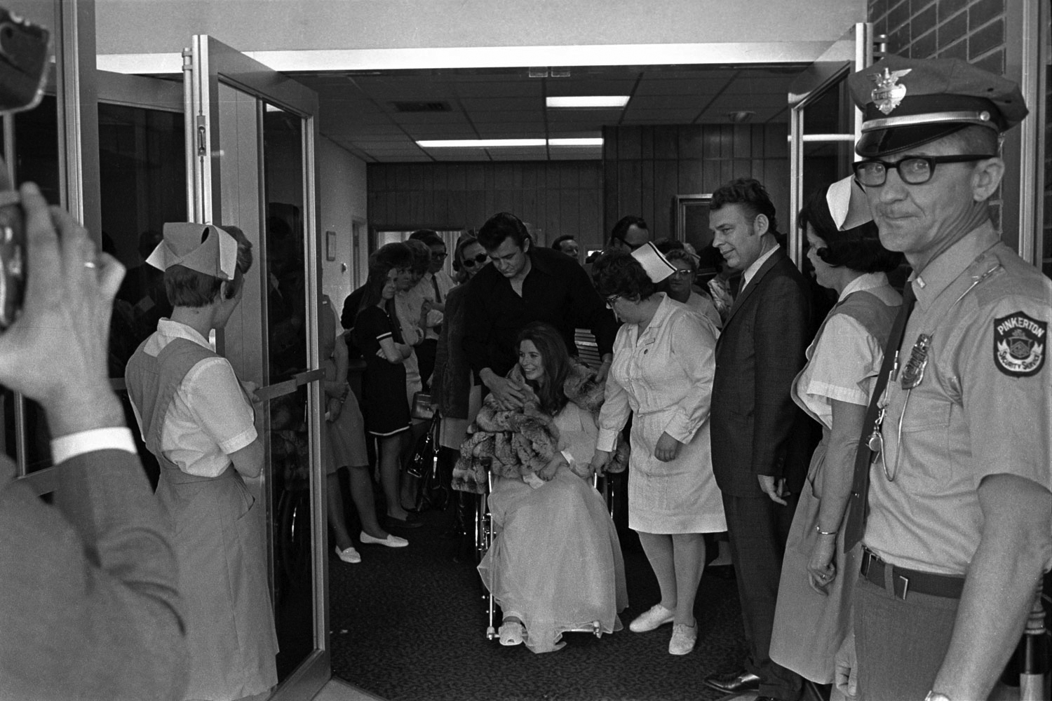 Leaving Madison Hospital with June and newborn son John Carter Cash, March 1970.