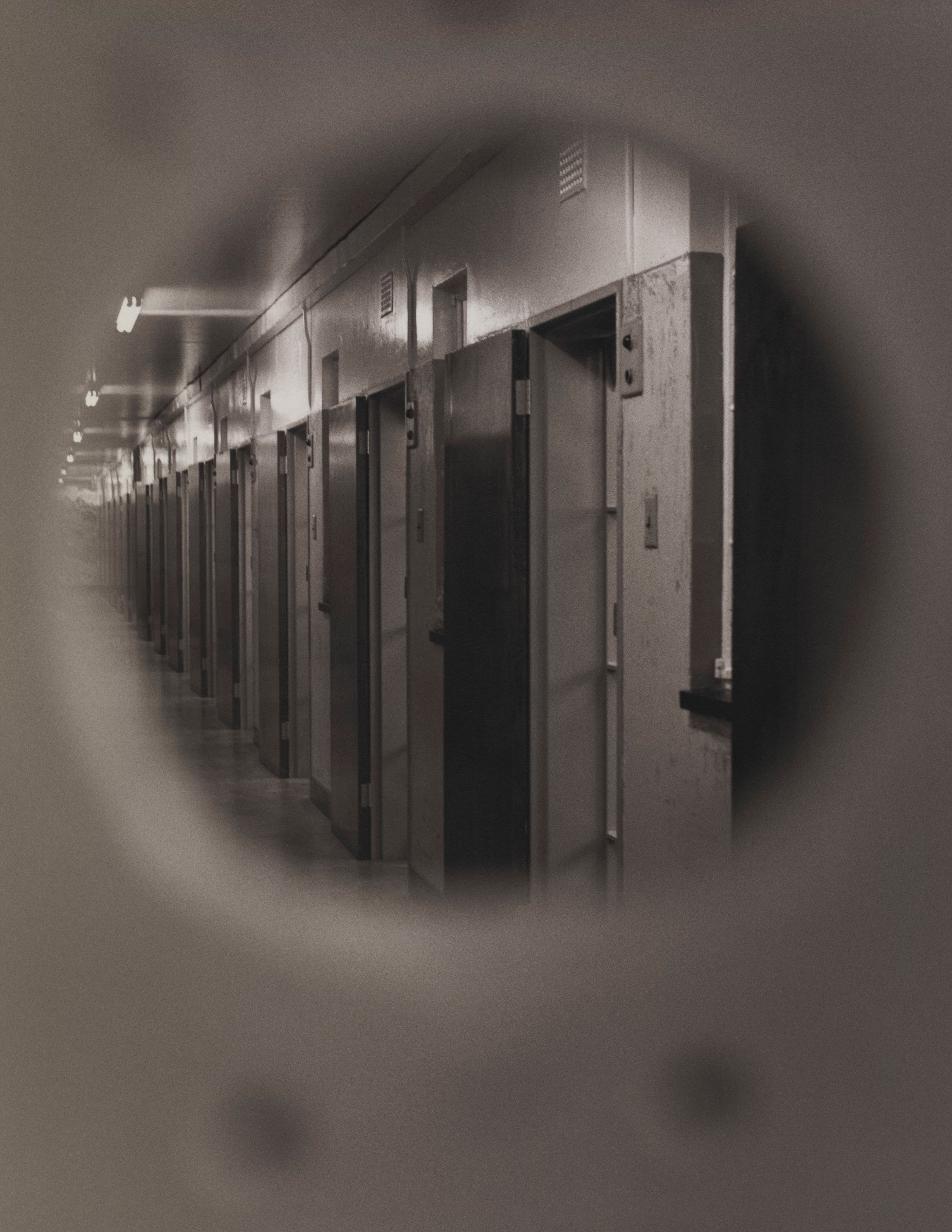 A glimpse through a prison cell's keyhole reveals a corridor near where Mandela spent much of his imprisonment.                                                                                             1992
