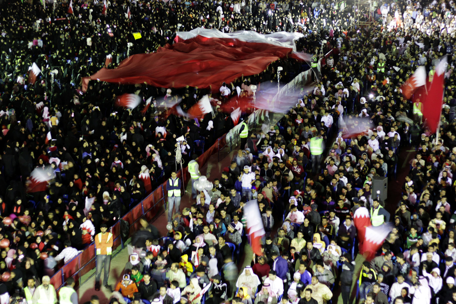 February 8, 2012. Tens of thousands of Bahrainis, many waving national flags, chant anti-government slogans during a sit-in calling for the fall of the regime and freeing of political prisoners in Muqsha, Bahrain.