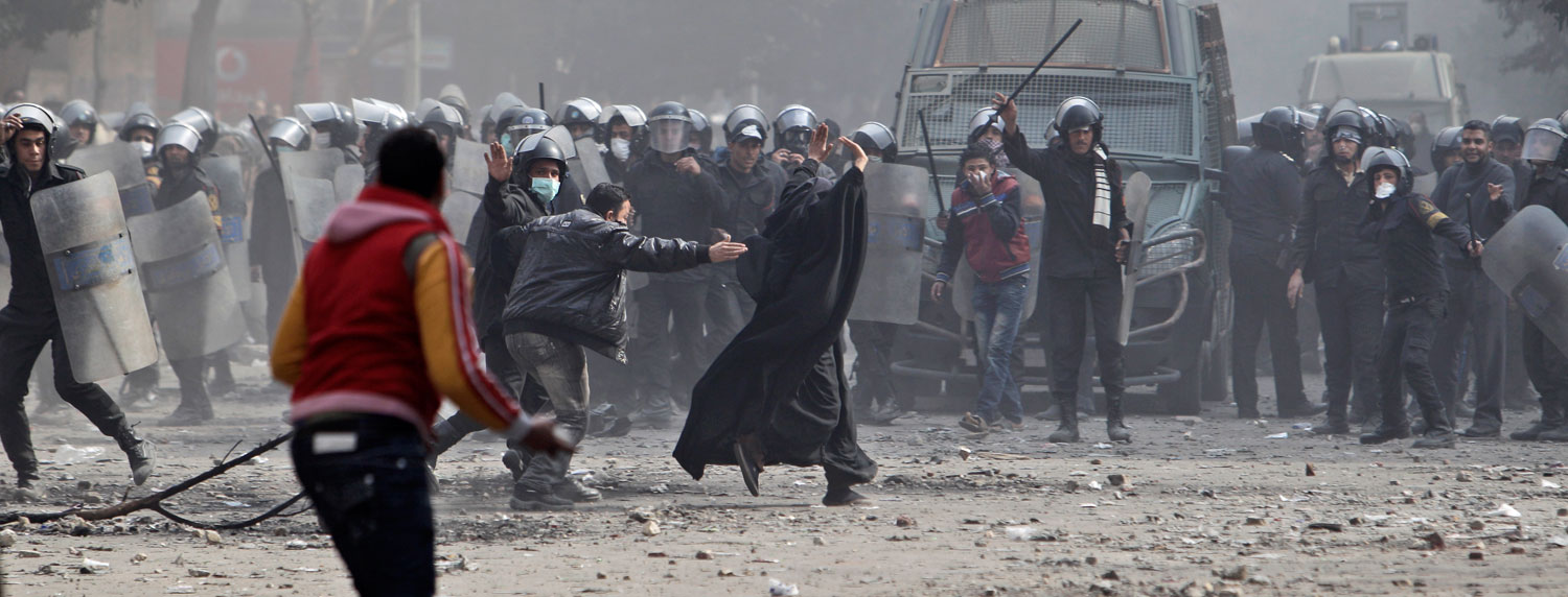 February 4, 2012. An Egyptian protester holds stones during clashes with security forces near the Interior Ministry in Cairo. The number of people killed in clashes with Egyptian security forces in the wake of a deadly soccer riot rose on Saturday, according to a field doctor and a security official, as demonstrators in Cairo kept up their calls for an end to military rule and retribution for those killed in the soccer game violence.