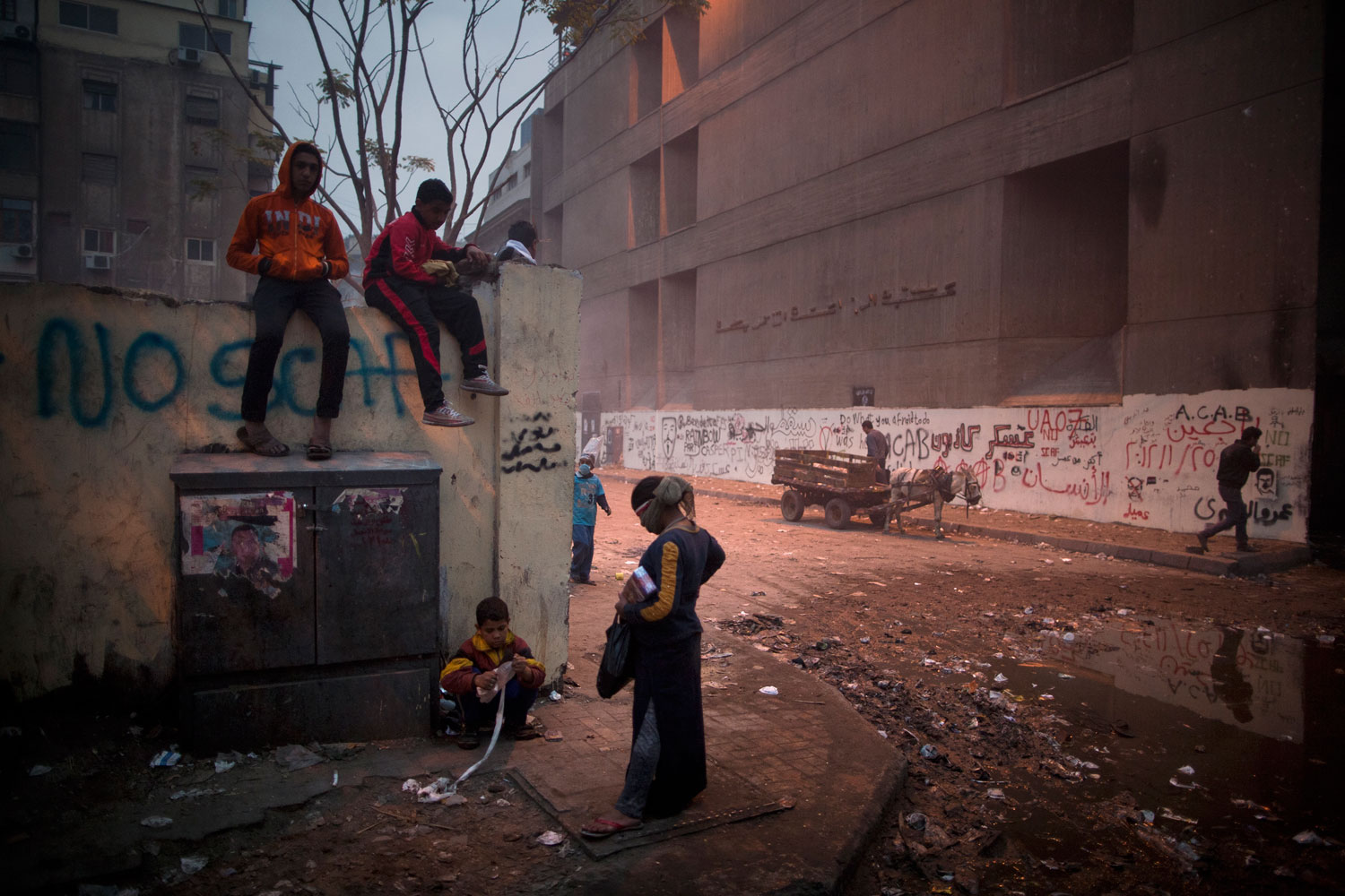 The following photographs were taken in Cairo in February 2012.Egyptian children hang around following street clashes on Mohamed Mahmoud street next to Tahrir Square.