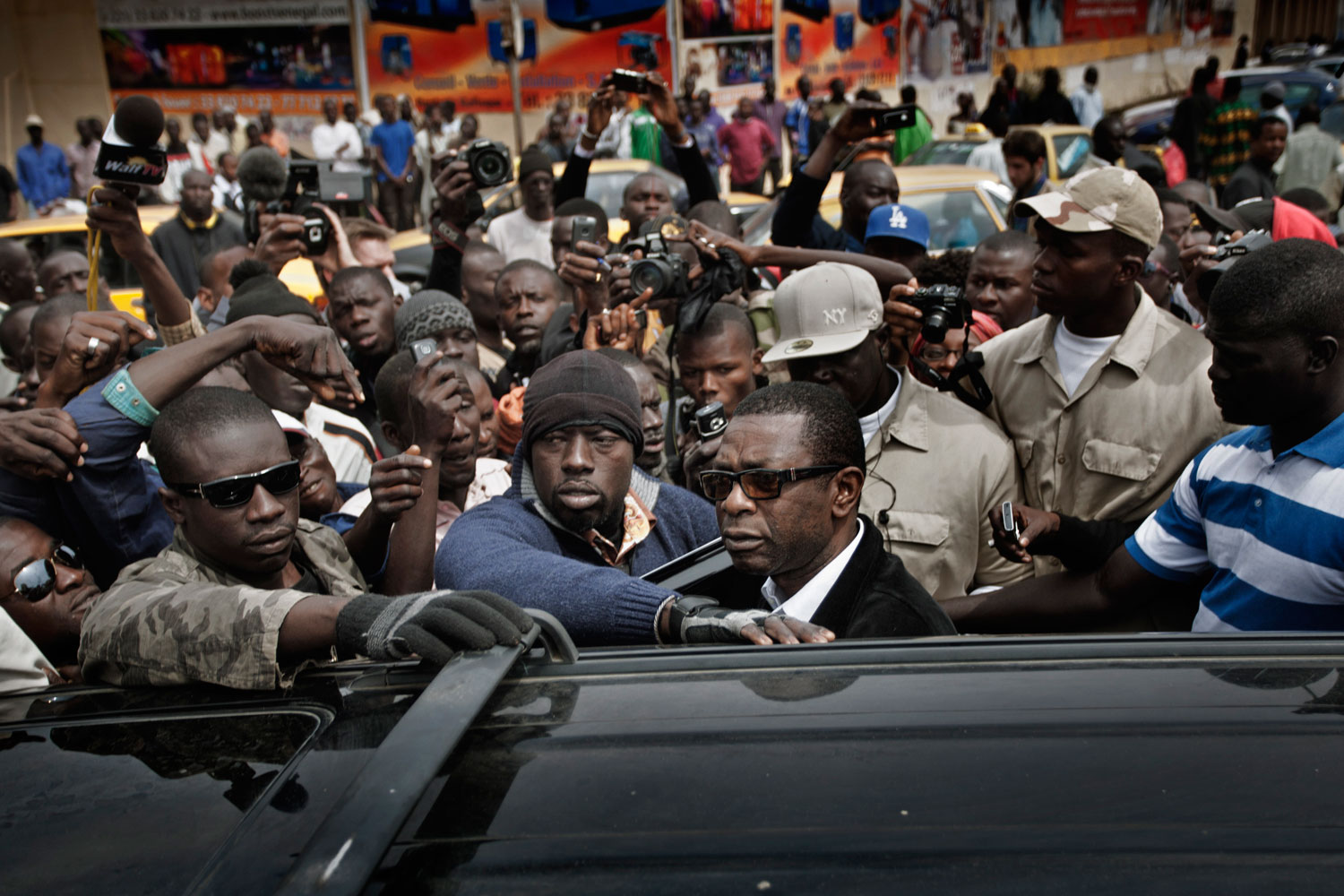 Dakar, Senegal, Feb. 15, 2012. Youssou N'Dour looks at the crowd forming around him in Independence Square after street clashes between protesters and police.
