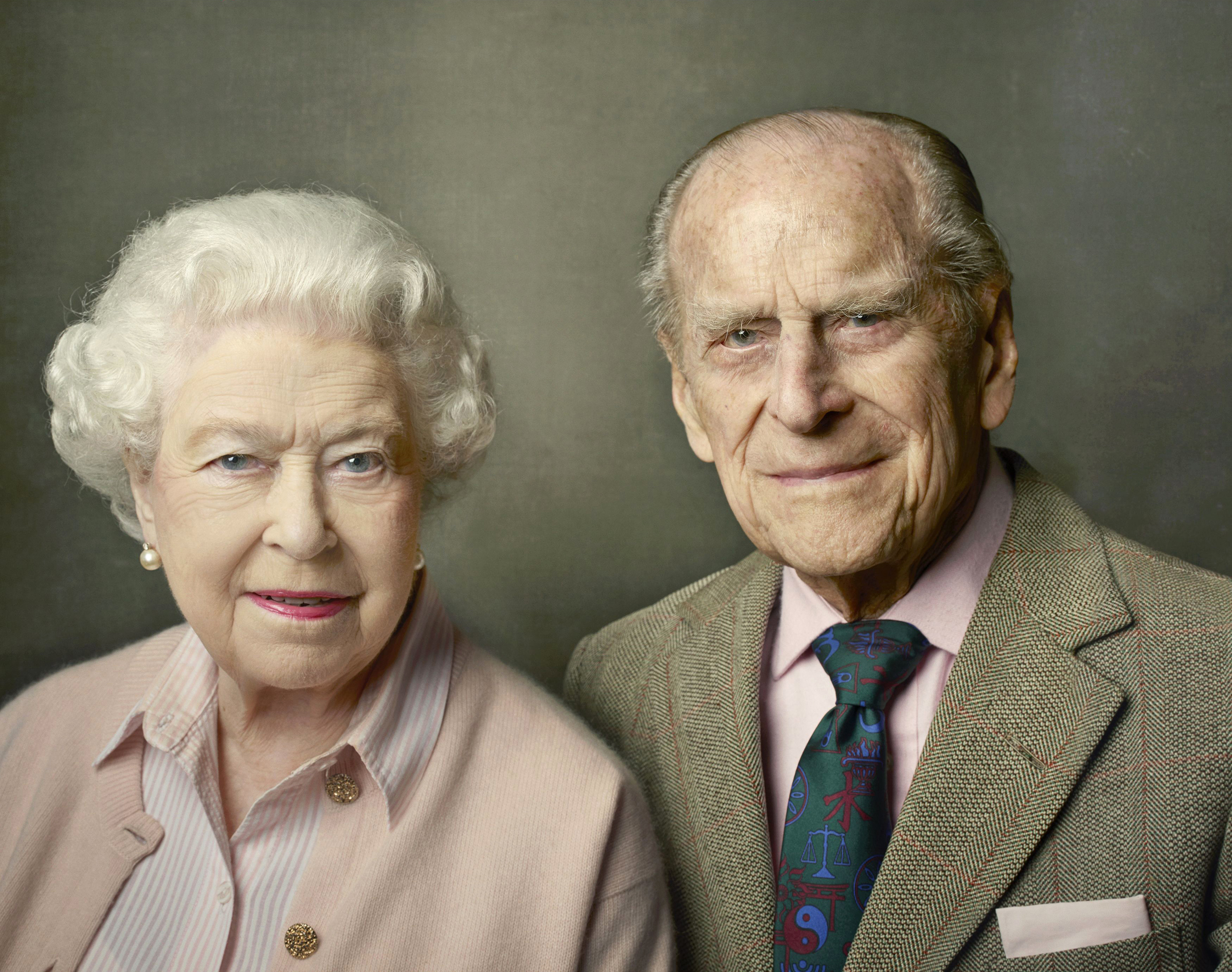 In this undated photo released by Buckingham Palace on June 10, 2016, Britain's Queen Elizabeth II and Prince Philip, the Duke of Edinburgh, pose for a photograph to mark the Queen's 90th birthday in Windsor. The queen, Britain's oldest and longest-reigning monarch, turned 90 on April 21. She usually celebrates her birthday privately, but this year's milestone served as the jumping off point for weeks of celebrations.