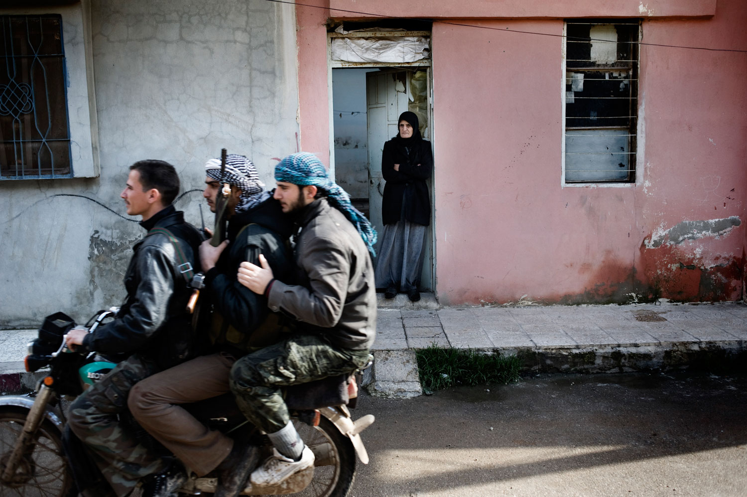 Members of the Free Syrian Army move their position in Al Qsair. Jan. 28, 2012