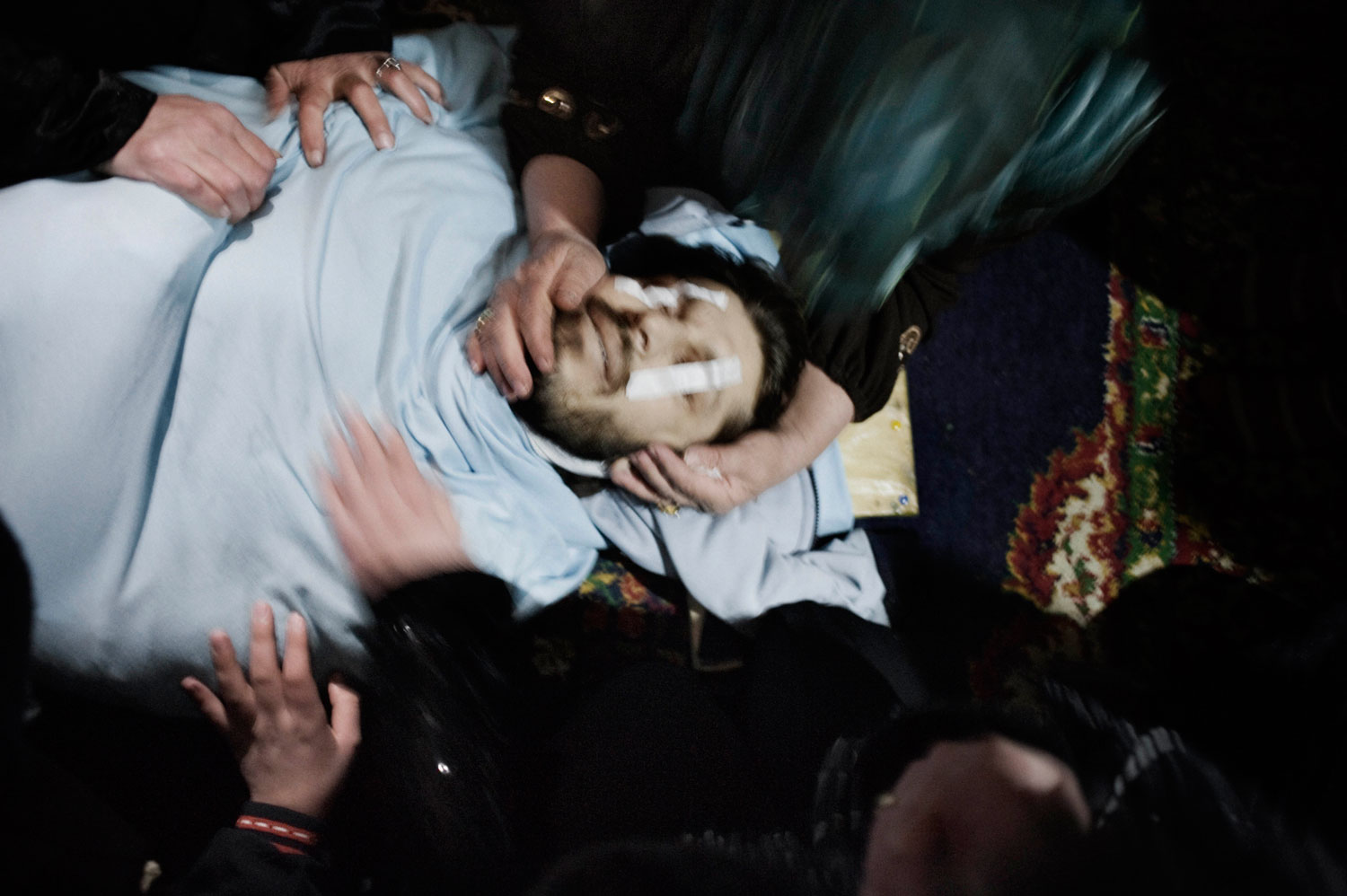 Mourners at the funeral of Asem Bader Waw, a 31-year-old shot dead by a Syrian army sniper in Al Qsair. Jan. 31, 2012