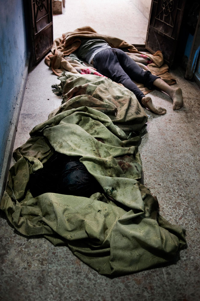 Dead Syrians in the entrance of a house that is used as a hospital in Bab Amr. Feb. 6, 2012