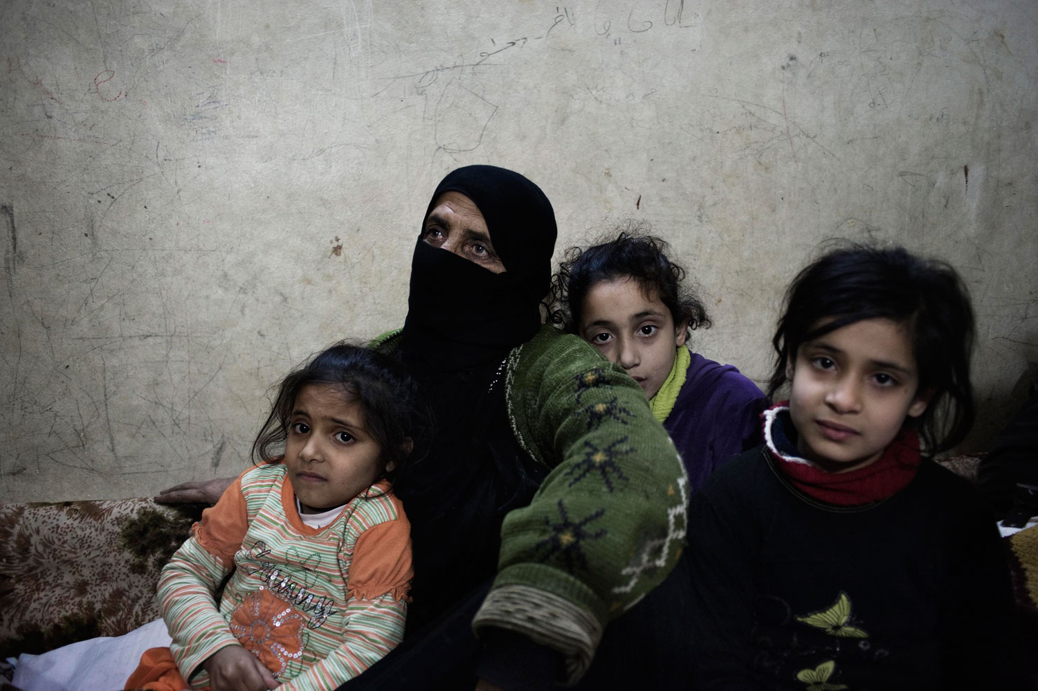 Families seek shelter from rocket attacks in Bab Amr. Feb. 6, 2012