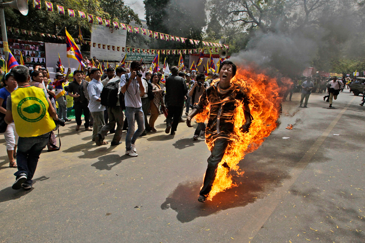 March 26, 2012. A Tibetan exile, identified as Jampa Yeshi, runs engulfed in flames after self-immolating during a demonstration in New Delhi.