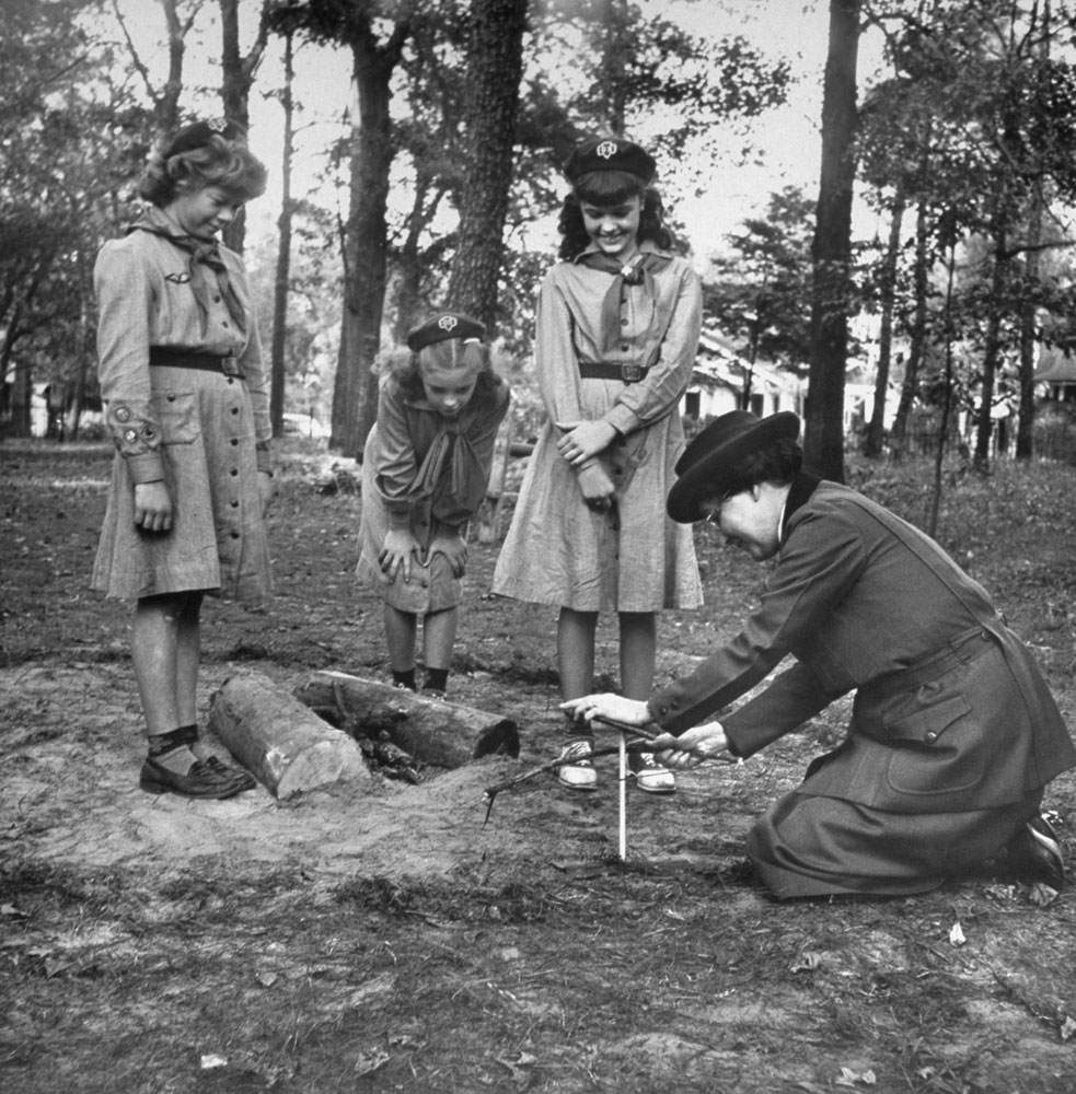 <b>Caption from LIFE.</b> Lighting fire with firebow, Mrs. Lawrence demonstrates friction method used in her day. The tinder failed to light. Today the Girl Scouts use matches.