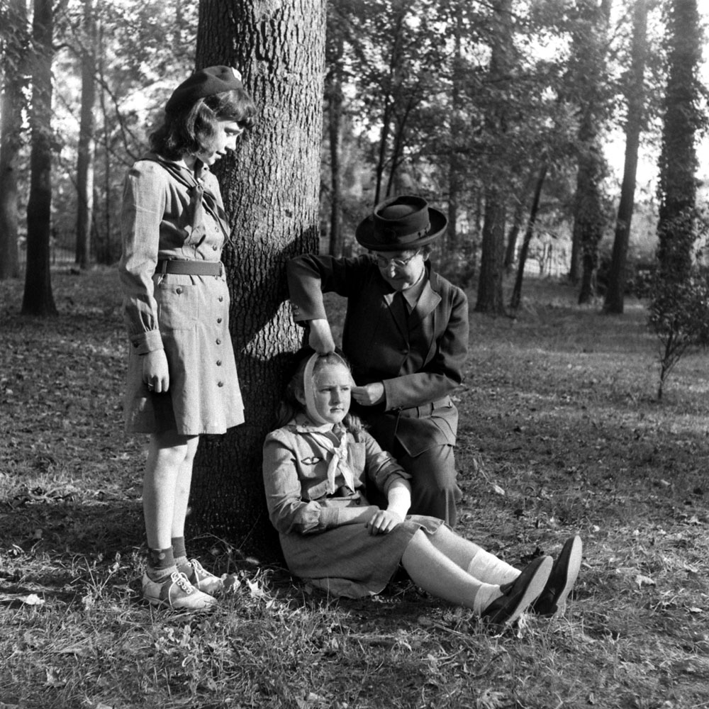 """The first Girl Scout,"" Daisy Gordon Lawrence, schools young Scouts on first aid in 1948."