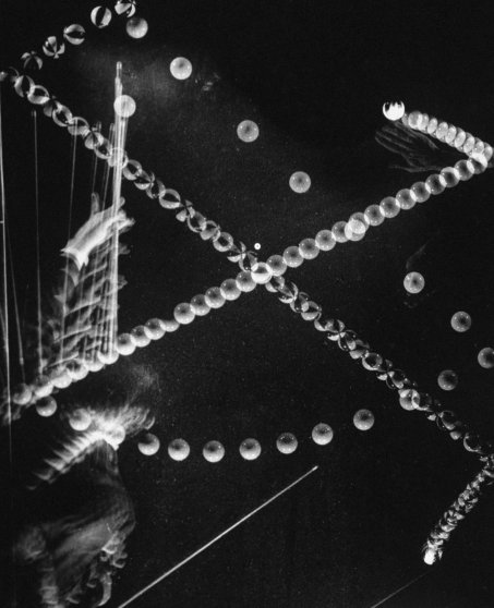 Stroboscopic image of a trick shot by billiards champion Willie Hoppe in 1941.