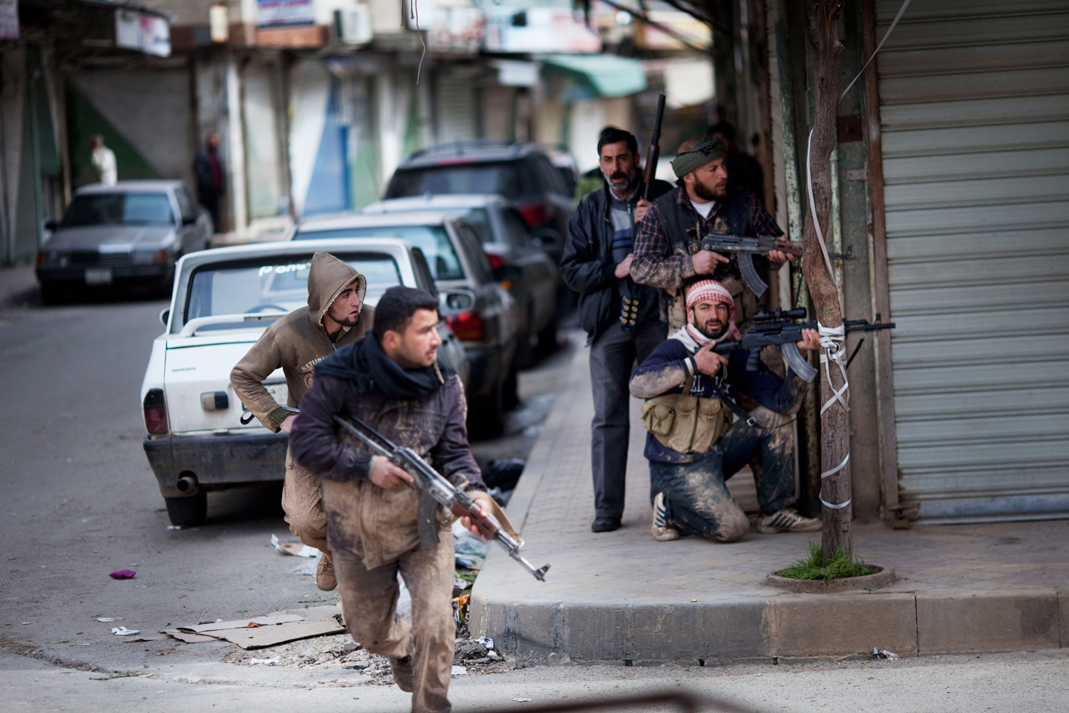 March 11, 2012. Syrian rebels take position during clashes with government forces in Idlib, north Syria.