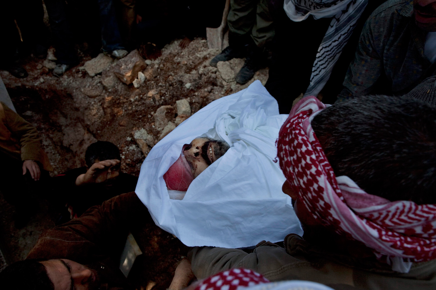 March 8, 2012. People carry the body of of Abdulaziz Abu Ahmed Khrer, killed by a Syrian Army sniper, during his funeral in Idlib, north Syria.
