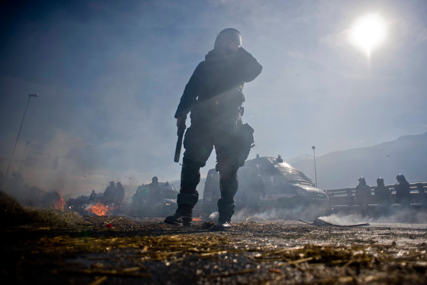 Feb. 28, 2012. Riot police stand guard during a sit-in protest against the construction of the TAV, near Chianocco, north of Turin, Italy.