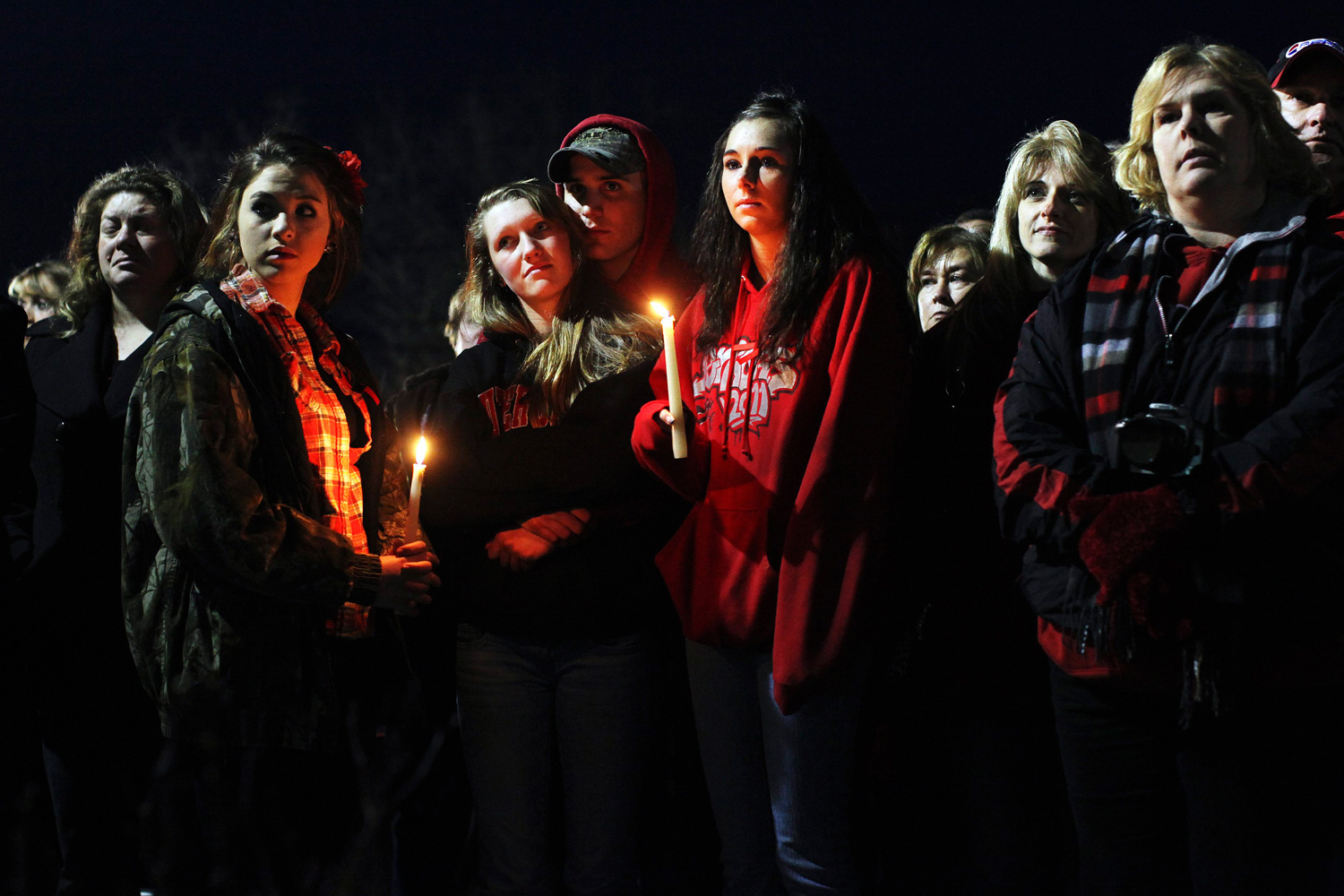 Feb. 28, 2012. People gather outside St. Mary's of Chardon for a candlelight vigil remembering the victims of a school shooting in Chardon, Ohio.
