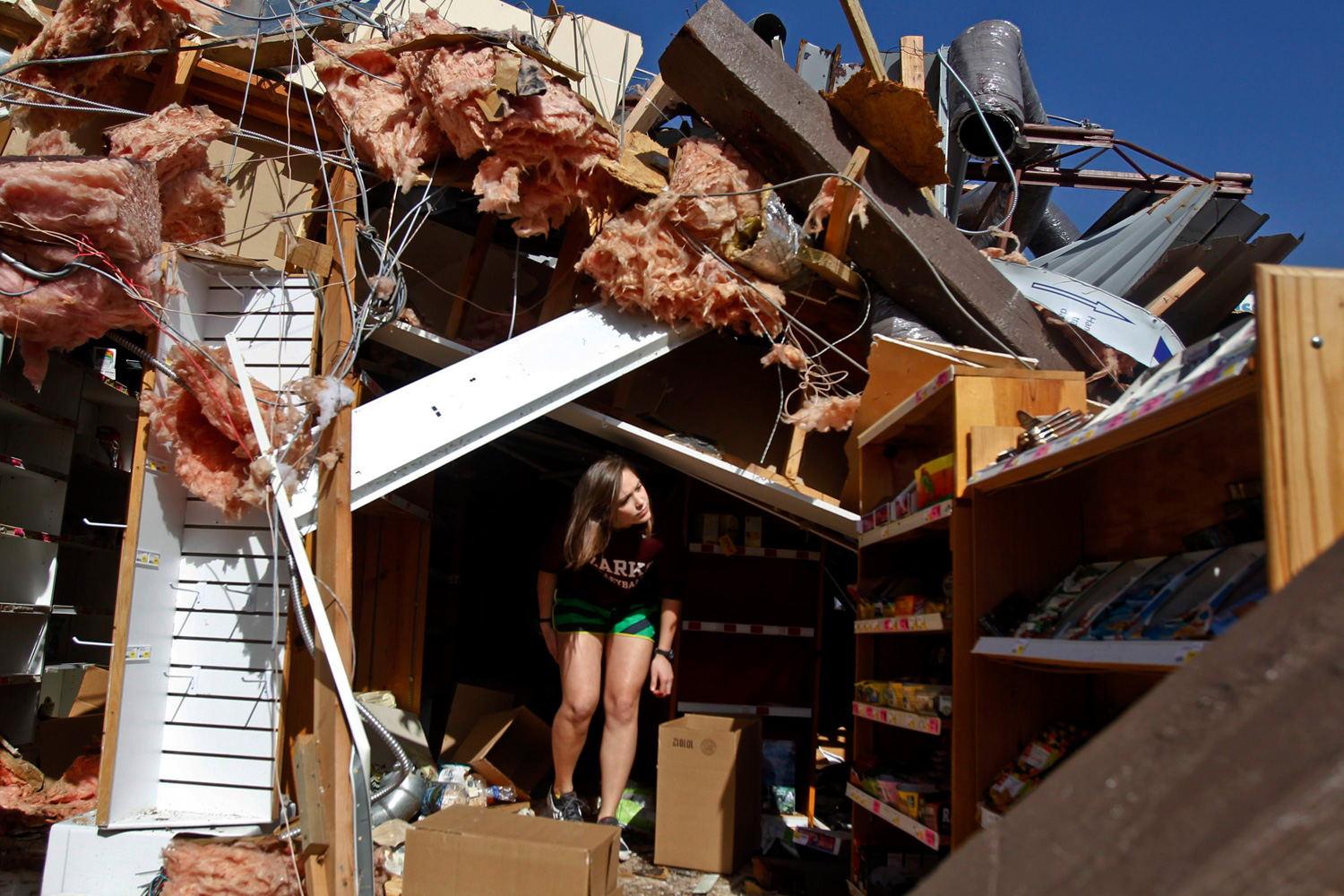 Feb. 29, 2012. Carissa Westfall helps salvage products from Nature's Sunshine Health Foods store in Branson, Mo. after storms spawned tornadoes that ripped through the U.S. Midwest.