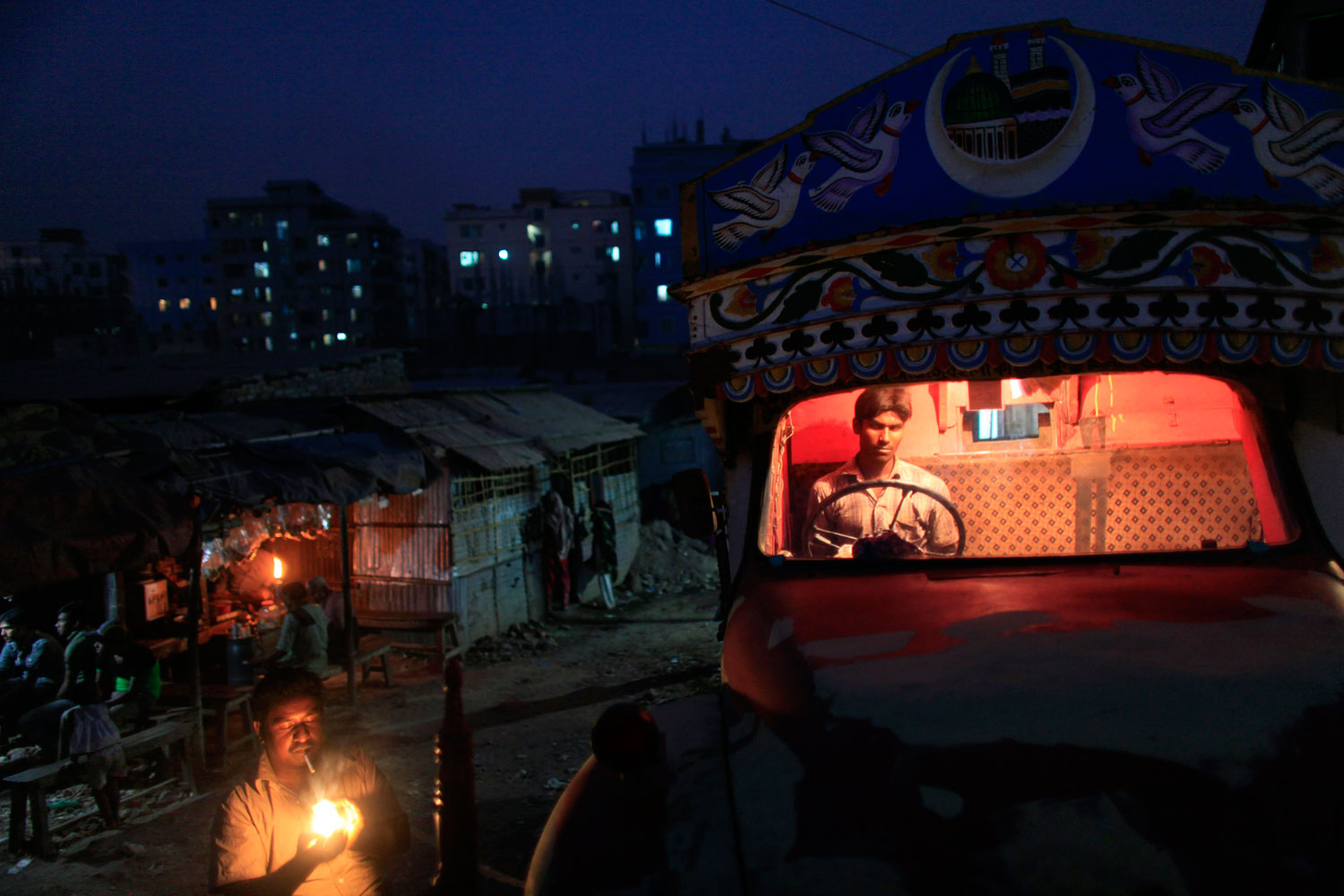 March 1, 2012. Drivers gather in front of a truck on the outskirts of Dhaka