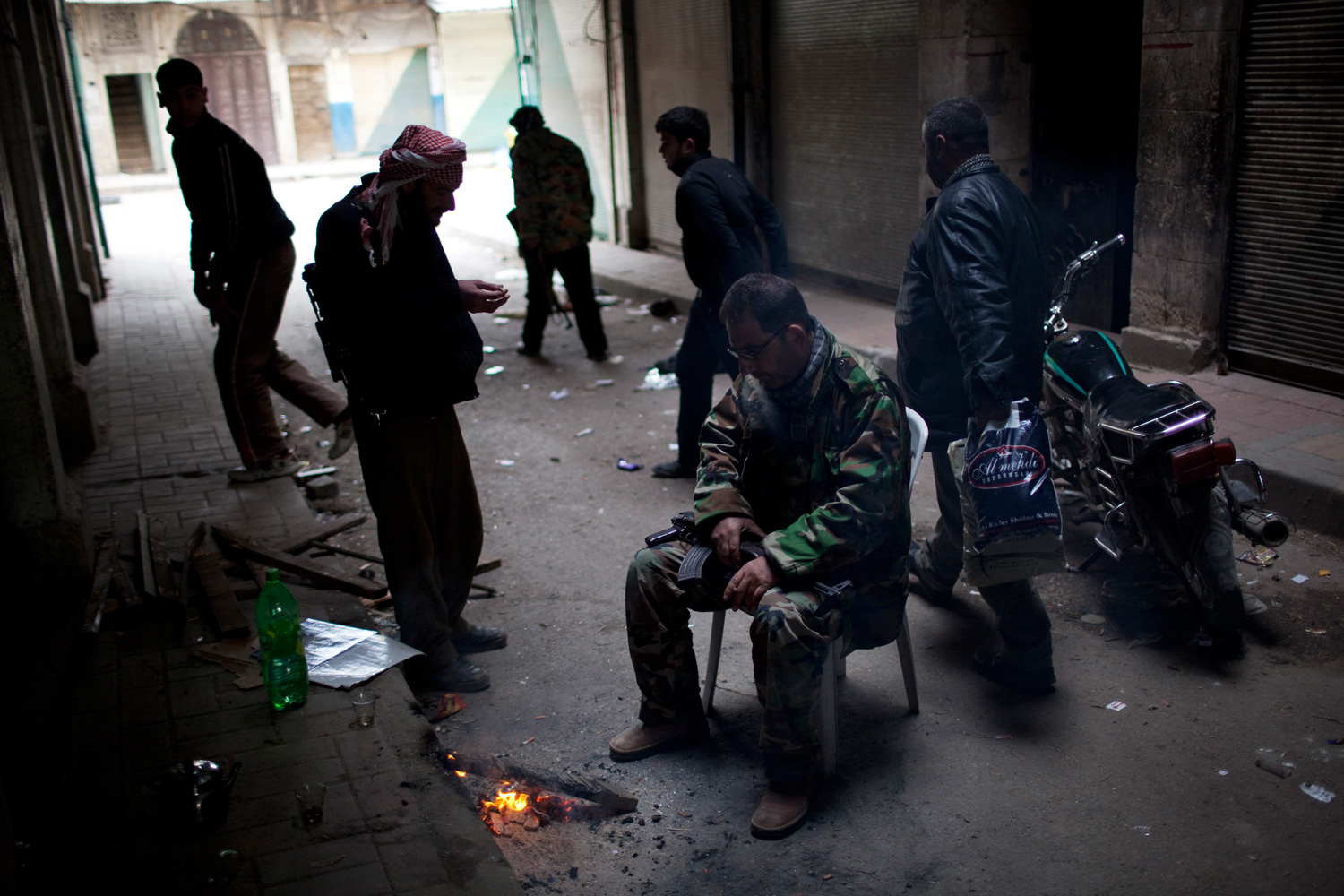 March 11, 2012. Syria rebels pause for a moment in between  fierce firefights with Syrian Army in the town of Idlib, north Syria. In the previous days, troops had encircled Idlib, and tank shells pounded the city from dawn until evening.