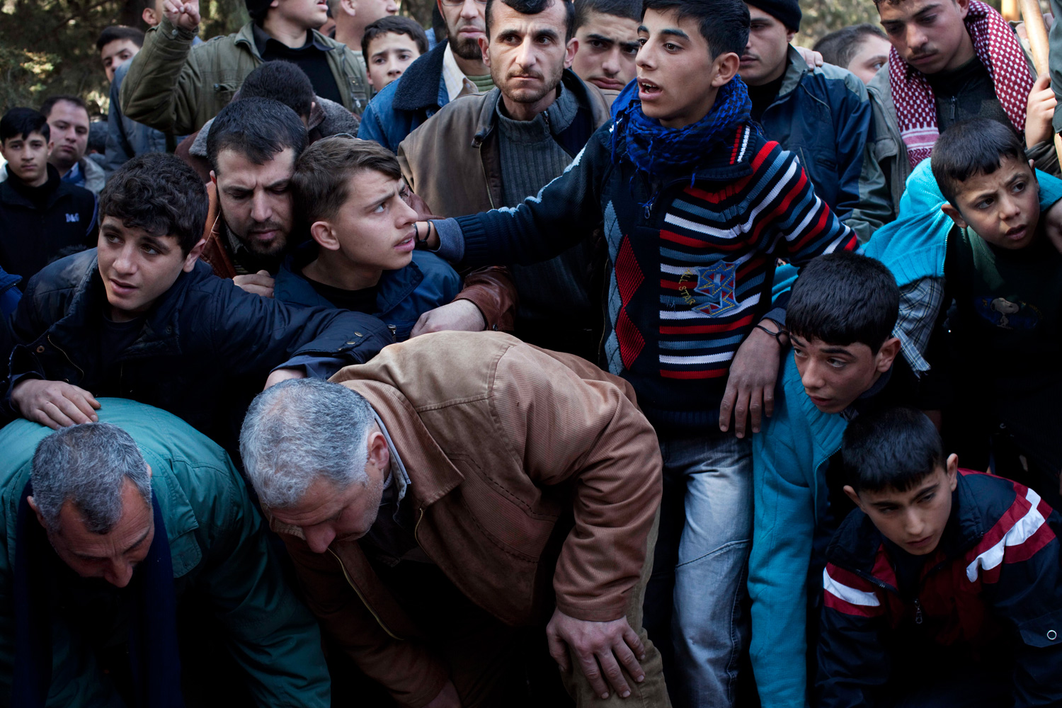March 8, 2012. Mourners attend the funeral for Abdulaziz Abu Ahmed Khrer, killed by a Syrian Army sniper, in Idlib, north Syria.
