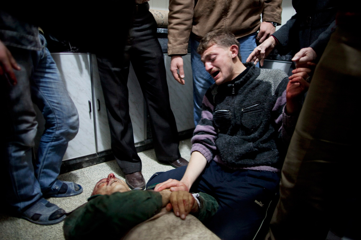 March 8, 2012. A relative mourns for Mohammed Munir Zidani, 59, minutes after he was killed by a Syrian Army sniper near a checkpoint in Idlib, north Syria.