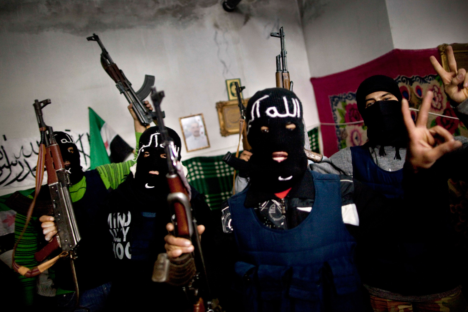 March 8, 2012. Free Syrian Army fighters gather after swearing to the Koran to fight against government troops until the last soldier is alive in Idlib, north Syria.