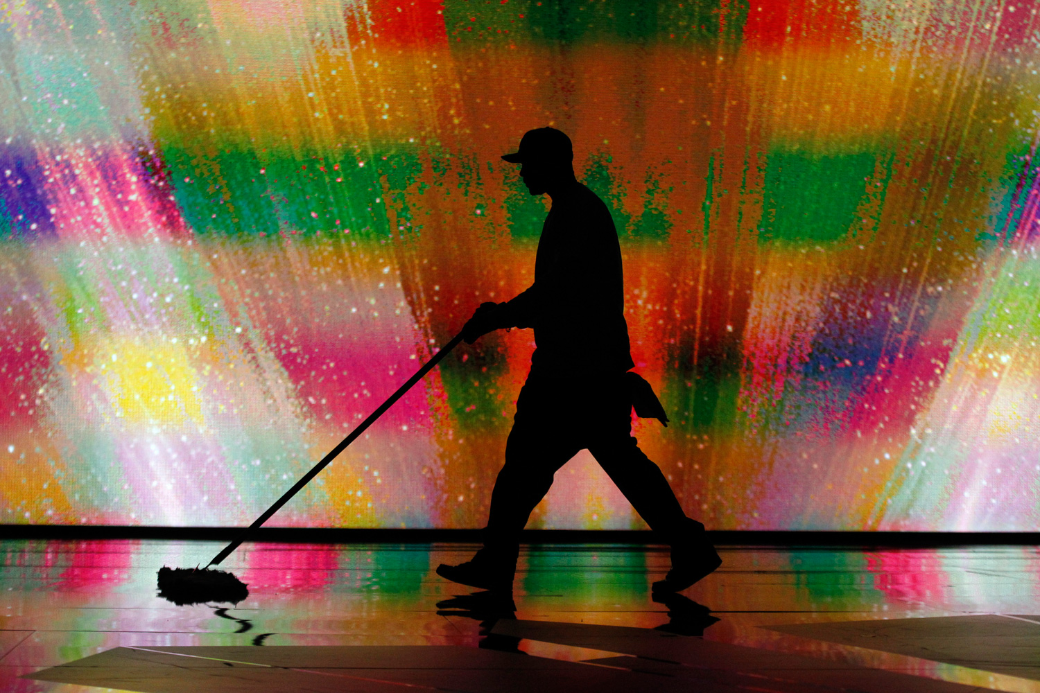 Feb. 25, 2012. A stage hands cleans the floor during rehearsals for 84th Academy Awards.