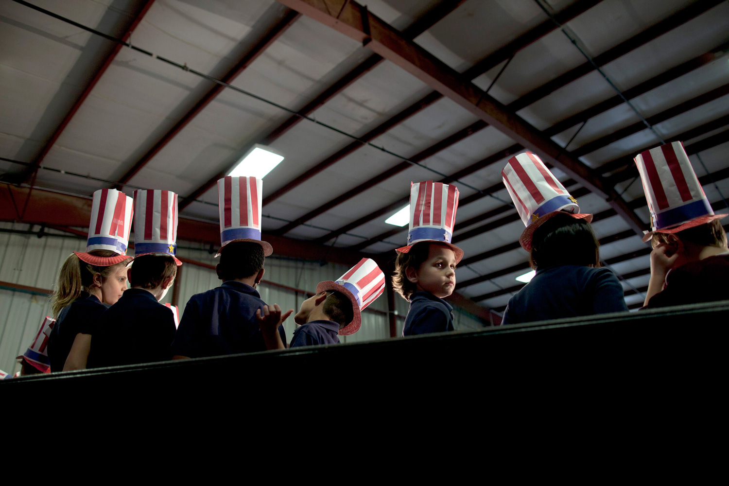 Feb. 29, 2012. Children from Peachtree Academy wait for Republican presidential candidate, former House Speaker Newt Gingrich to arrive for a campaign rally.